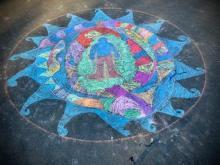 Radial sidewalk art, human figure at the center