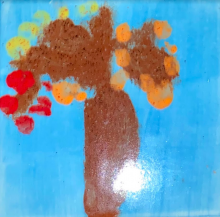 Painting on ceramic, impressionistic tree on blue background
